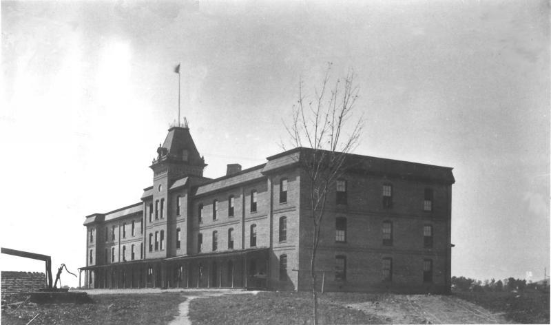 Photograph of Barracks No. 1, the first dormitory on campus (now Lane Hall)