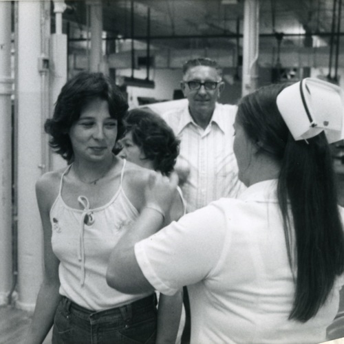 Vina Davis Giving a Shot to Debbie Reece Burcham (Ms1989-039)