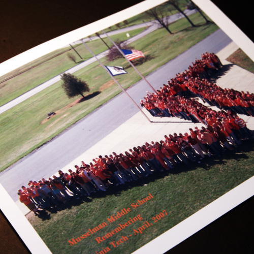 Photograph of Musselman Middle School students forming a large VT sign and a letter from Principal