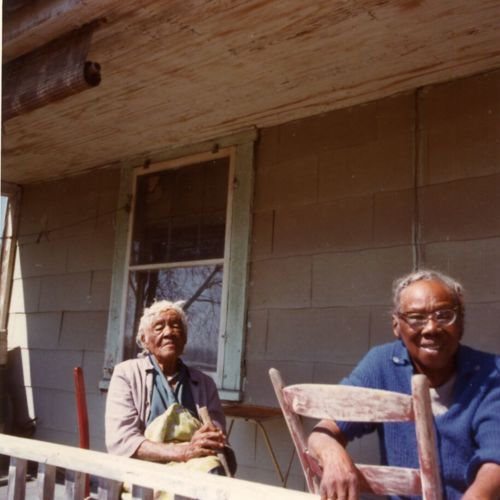 Photograph, Laura Lee Anderson and [unknown] on the porch of a house in New Town