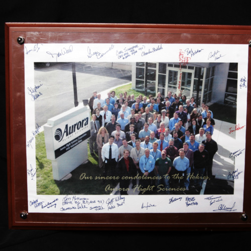 Photograph of Aurora Flight Sciences employees with signatures