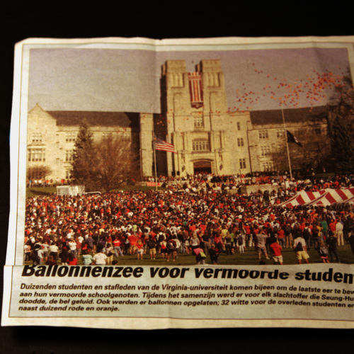 Newspaper clipping from newspaper in Holland showing gathering on Drillfield in front of Burruss Hall