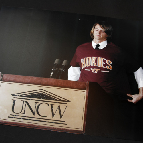 Photographs of a student and placard from the  University of North Carolina at Wilmington