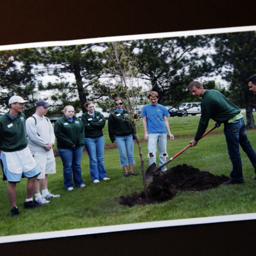 Photograph from Southeast Community College - Lincoln Campus Student Senate representatives planting a tree in memory of VT victims.