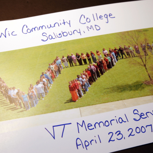 Card with a photograph of Wor-Wic Community College students forming a VT sign