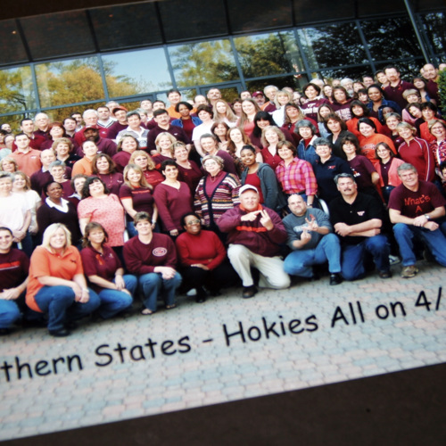 Photograph of Southern States Cooperative employees wearing orange and maroon colors