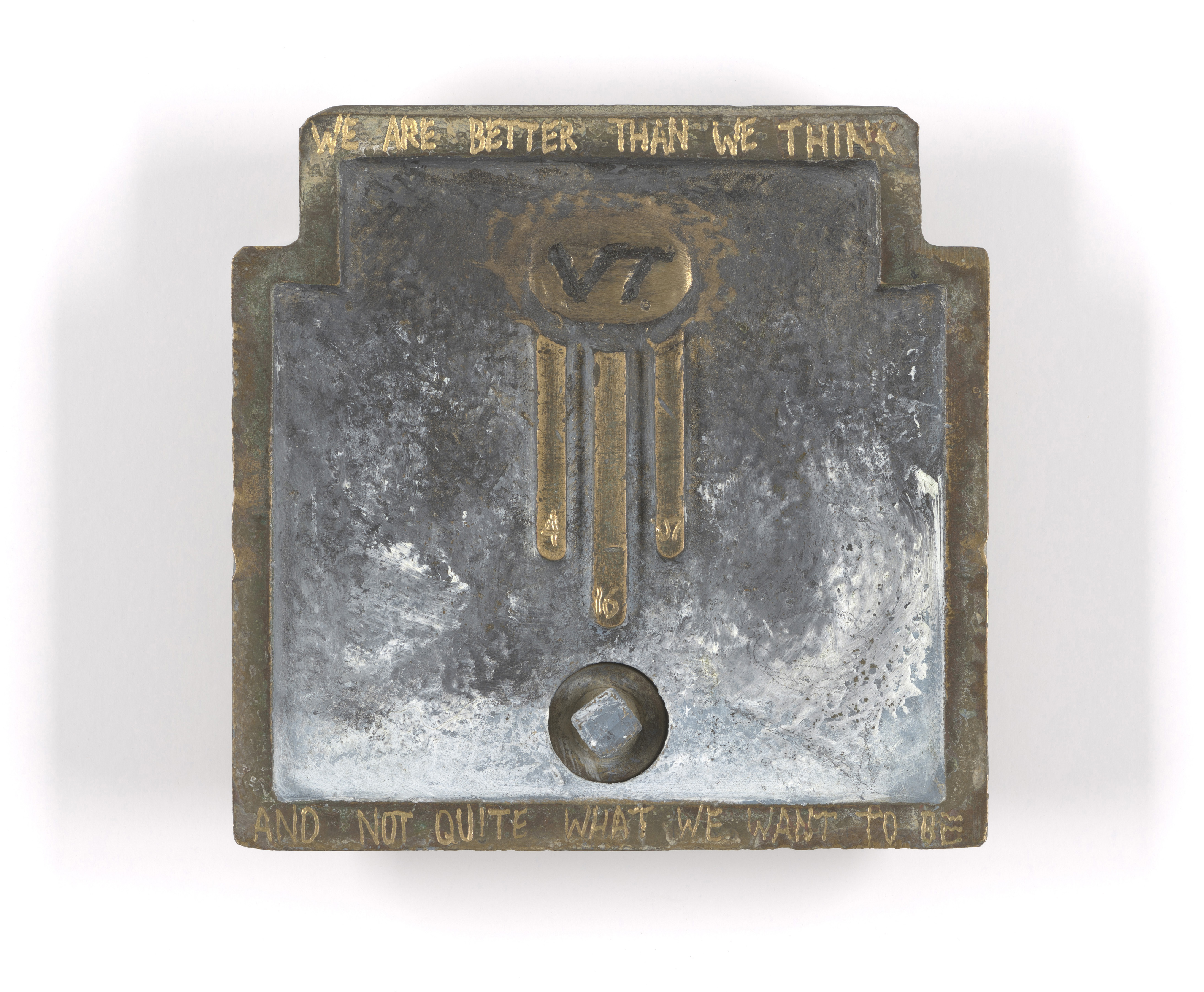 metal piece by artist Eric W. Schuttler inscribed We are better than we think, and not quite what we want to be