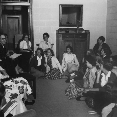 Photograph, Mildred Tate talking to female students, 1955
